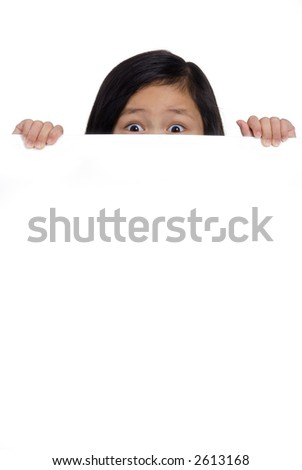 A young girl hold up a blank board and peeks over the top.