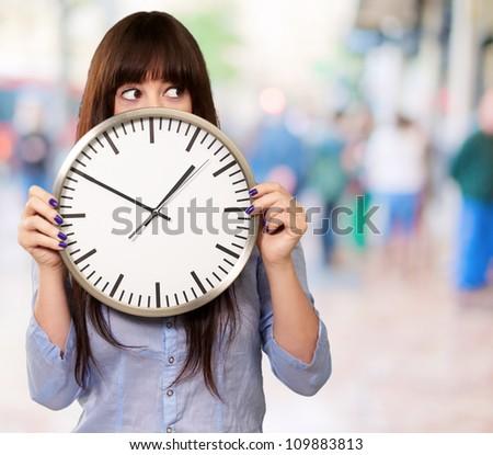 A Young Girl Holding A Clock, Outdoor