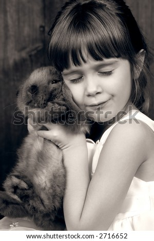 A young girl holding her bunny