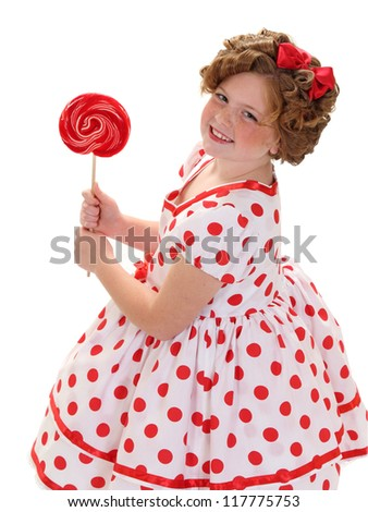 A young girl holds a red lollipop isolated on white - stock photo