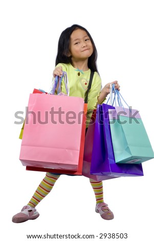 A young girl holds her bags after a hard day of shopping