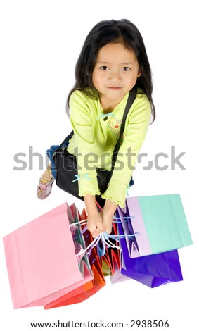 A young girl holds her bags after a hard day of shopping - stock photo