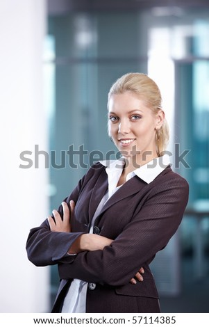 A young girl in a business suit