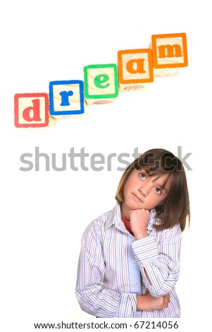 A young girl in a dreaming posture with the word dream above in blocks.