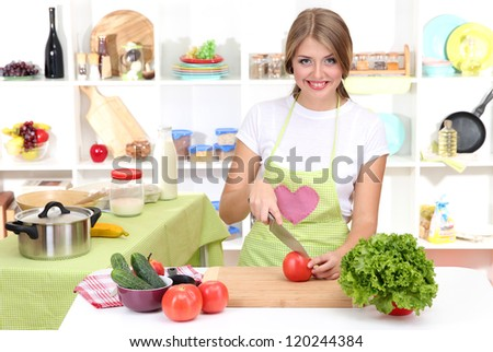 A young girl in kitchen while cooking