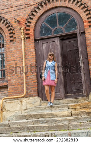 A young girl in sunglasses on the street in the center of Lviv, Ukraine