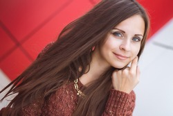 a young girl in the interior, red,smile ,eyes,makeup,portrait