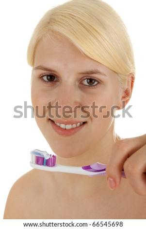 A young girl is brushing her teeths