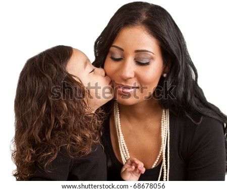 A young girl kisses her mother who closes her eyes