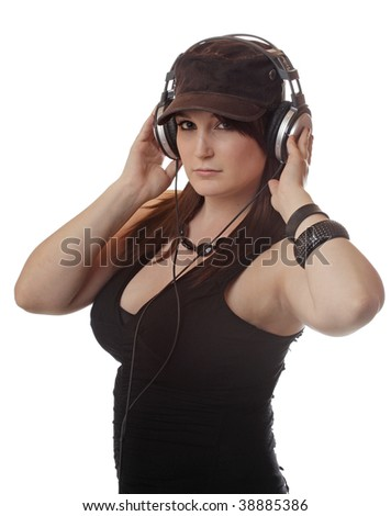 A young girl listens to a large set of headphones.