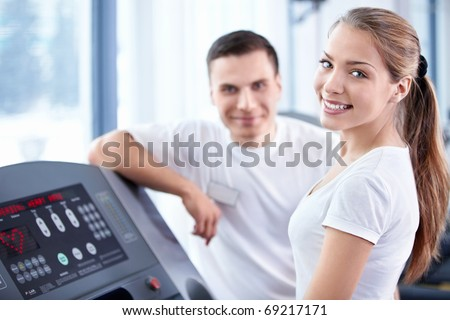 A young girl on a treadmill