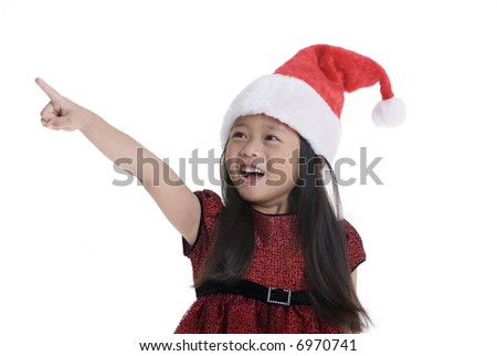 A young girl pointing at something...Santa???Childhood, Christmas.