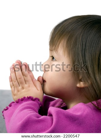 A young Girl prays at the table