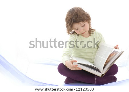 A young girl reading a book - stock photo