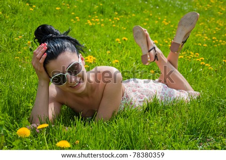 A young girl rests in a park