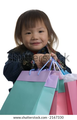 A young girl shopping for Christmas presents, the bags are all full.