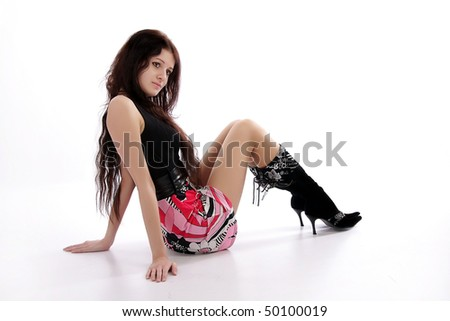 a young girl sitting on the floor isolated on white