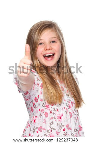a young girl smiling and giving thumbs up