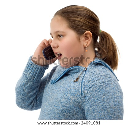 A young girl talking on a cell phone, isolated against a white background