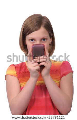 A young girl texting messages on a smart phone