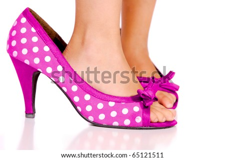 A Young Girl Walking In Mummy 's Shoes