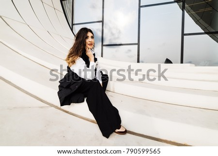 a young girl walks around the city in the middle of the day