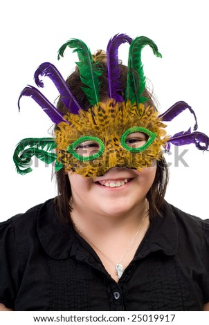 A young girl wearing a feather mask, isolated against a white background