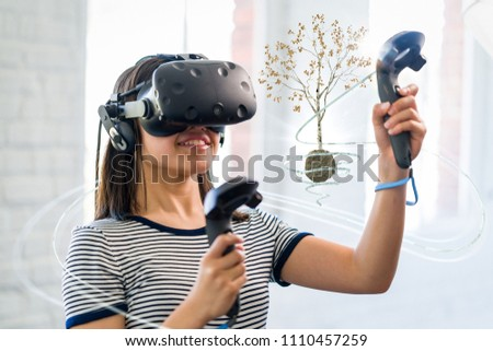 A young girl wearing a virtual reality headset #1110457259