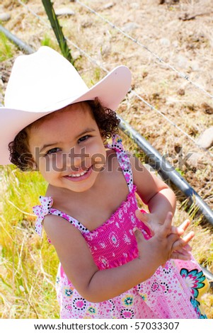 c0689aa15ba Free photos Young girl wearing cowboy hat and boots