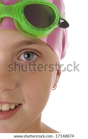 A young girl with a swimming cap and goggles on a white background