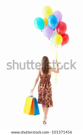 A young girl with balls and bags on white background