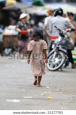 a young girl with money in her right hand on the way to a market in phnom penh
