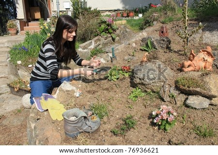 a young girl working in the garden
