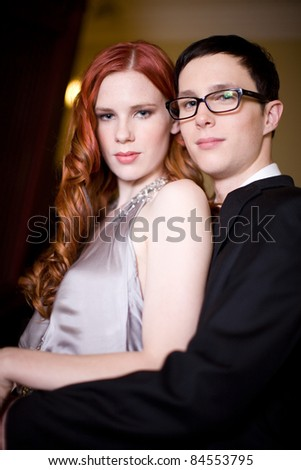 A young glamorous looking couple in formal wear