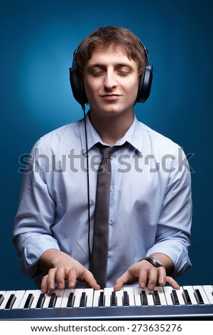 a young guy listening to music student, musician. concept of education, music studio