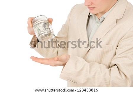 a young guy trying to extract money from a glass container isolated on white background - stock photo