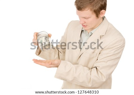 a young guy trying to extract money from a glass container isolated on white background