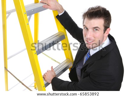 A young handsome business man climbing a ladder isolated over white - stock photo