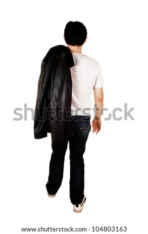 A young handsome man with a black leather jacket walking from the back in the studio for white background.
