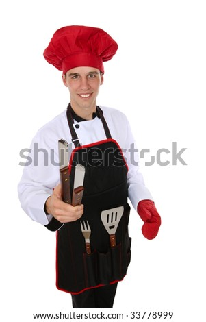 A young handsome man with barbecue tools