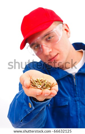 A young handyman showing / offering a bunch of screws - isolated on white.