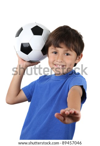 A young happy boy holds up a soccer ball - on a white background