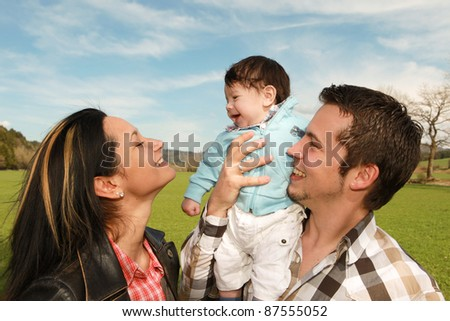 A young happy family with their 4  month old son