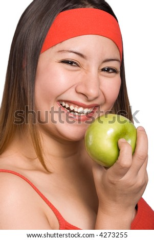 A young happy female holding a green apple