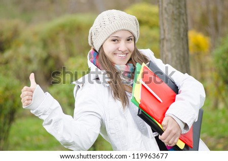 A Young Happy Girl coming from school through forest