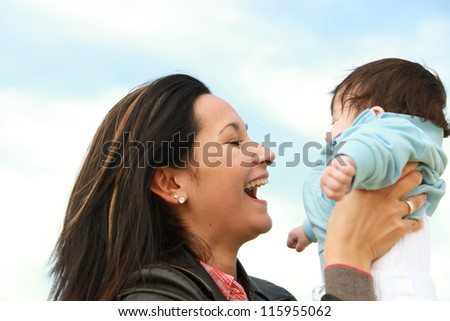 A young happy mother 22 years with her 4  month old son