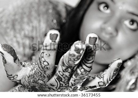 A young Hindu Bride shows off her traditional Henna designs before the wedding