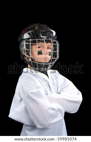 A young hockey player posing with attitude.