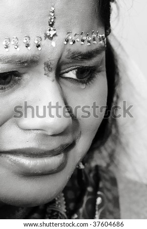 A young Indian bride crying
