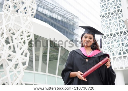 a young indian female graduate during her convocation day.